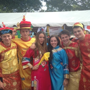 Trying on outfits at the Chinese Society stall