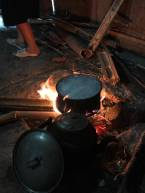 After getting fresh produce from the market (there was no fridge to store food) and wood to start the fire