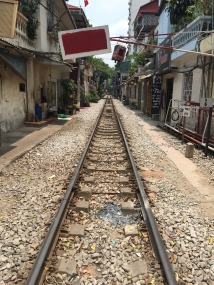 Train tracks running right outside people's front door